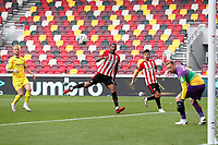 6th September 2020; Brentford Community Stadium, London, England; English Football League Cup, Carabao Cup, Football, Brentford FC versus Wycombe Wanderers; Ethan Pinnock of Brentford heads the ball to score his sides 1st goal in the 34th minute to make it 1-0