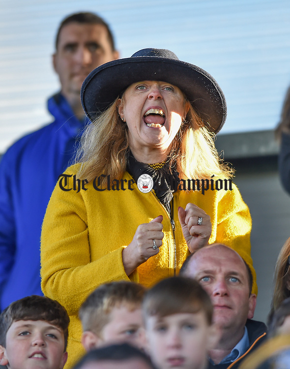 A Ballyea fan urges on her team late during the county senior hurling final against Cratloe at Cusack Park. Photograph by John Kelly.