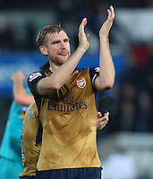 Per Mertesacker of Arsenal celebrates at full time during the Barclays Premier League match between Swansea City and Arsenal played at The Liberty Stadium, Swansea on October 31st 2015
