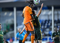 LAKE BUENA VISTA, FL - JULY 18: Alberth Elis #7 of the Houston Dynamo rises above Jorge Villafaña #4 of the Portland Timbers to win the header on a corner during a game between Houston Dynamo and Portland Timbers at ESPN Wide World of Sports on July 18, 2020 in Lake Buena Vista, Florida.