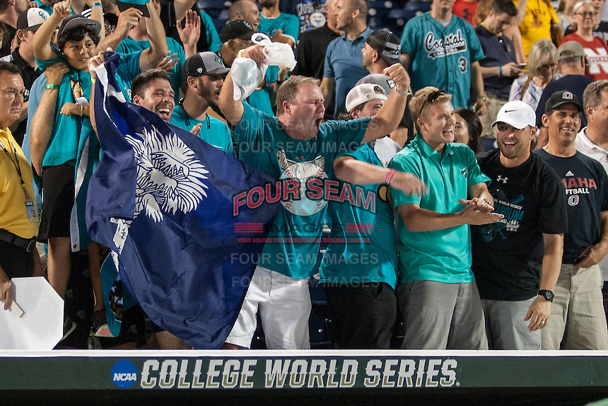 Coastal Carolina Chanticleers fans celebrate defeating the Florida Gators in Game 4 of the NCAA College World Series on June 19, 2016 at TD Ameritrade Park in Omaha, Nebraska. Coastal Carolina defeated Florida 2-1. (Andrew Woolley/Four Seam Images)
