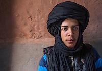 Morocco.  Teenage Amazigh Berber Young Man in Turban, Ait Benhaddou Ksar, a World Heritage Site.