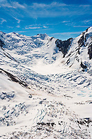 View from the air, of a massive ice and snow field in the Tordrillo Mountains, Alaska Range.  Shot from helicopter.