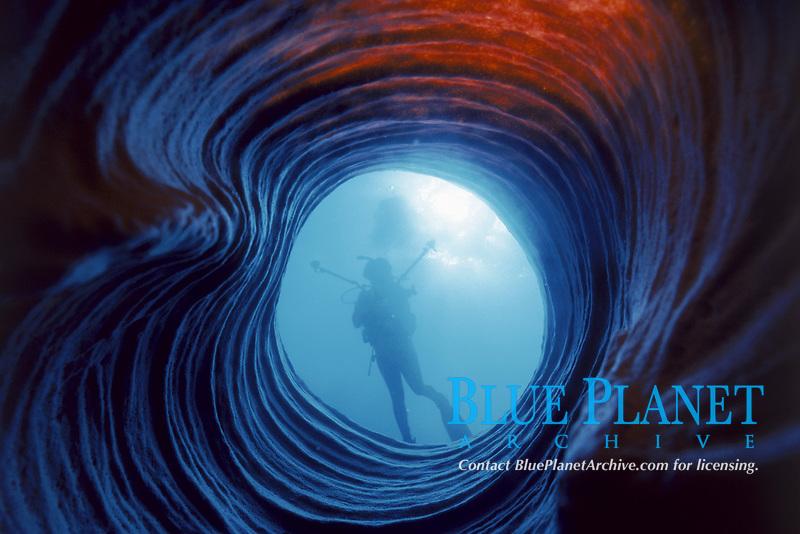 silhouette of scuba diver as viewed through barrel sponge