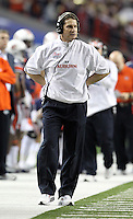 ATLANTA, GA - DECEMBER 31: Head coach Gene Chizik of the Auburn Tigers coaches his team during the 2011 Chick Fil-A Bowl against the Virginia Cavaliers at the Georgia Dome on December 31, 2011 in Atlanta, Georgia. Auburn defeated Virginia 43-24. (Photo by Andrew Shurtleff/Getty Images) *** Local Caption *** Gene Chizik