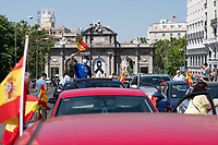 MADRID, SPAIN - MAY 23: A man waves a Spanish flag from a car during the demonstration organized by VOX, Spanish far-right party and third biggest party in the Parliament, to demand the resign of the national Government on 23 May 2020, in Madrid, Spain. This protest, which should be participated from the car, occurs in the middle of deescalation plans of covid 19 and the state of emergency remains active due to the coronavirus. (Photo by Sergio Belena / VIEWpress).