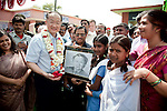 12 March 2013, Kanpur, Uttar Pradesh India: President of the World Bank, Mr Jim Yong Kim speaks with children who presented him with a portrait on his visit to the village of Tilsarikhurd village near to the city of Kanpur in Uttar Pradesh state. Mr.Kim is visiting India  for meetings with local staff, Indian Government Ministers and to inspect projects sponsored by World Bank in regional areas. Picture by Graham Crouch/World Bank