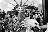 USA. New York City's Battery Park. Statue of Liberty and bald eagle. World Trade Center Towers. Hands Across America was a benefit event and publicity campaign staged on Sunday, May 25, 1986 in which approximately 7 million people held hands in a human chain for fifteen minutes to form a line that stretched 4,152 miles (6,682 km) – from New York City's Battery Park to Long Beach, California along a path across the continental United States. 25.05.86 © 1986 Didier Ruef