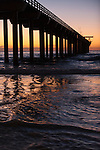 La Jolla Shores, La Jolla, California; a colorful, sunset sky viewed through the pilings of Scripps Pier as it extends out over the Pacific Ocean