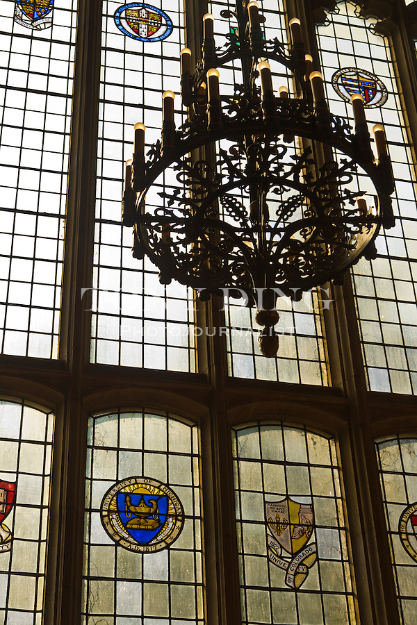 The stained glass windows inside the Michigan Law School's library depict the university crests of fellow world-class academies, Friday, Sept. 2, 2011 in Ann Arbor, Mich. (Tony Ding for The New York Times)