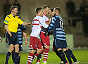 Referee Gavin Ross tries to regain control as players face up to each other after Stirling keeper Callum Reidford reacts to Forfar's Dale Hilson challenge.