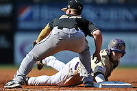 First baseman Brett Hash (27) of the Wofford Terriers take a pickoff throw in a SoCon Tournament game against Western Carolina on Wednesday, May 25, 2016, at Fluor Field at the West End in Greenville, South Carolina. Western won, 10-9. (Tom Priddy/Four Seam Images)