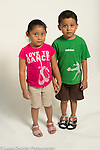 6 year old fraternal twins boy and girl portrait against white background