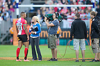 20120803 Copyright onEdition 2012©.Free for editorial use image, please credit: onEdition..Sarra Elgan of ESPN interviews Ashley Smith of London Welsh after their match against London Irish 7s at The Recreation Ground, Bath in the Final round of The J.P. Morgan Asset Management Premiership Rugby 7s Series...The J.P. Morgan Asset Management Premiership Rugby 7s Series kicked off again for the third season on Friday 13th July at The Stoop, Twickenham with Pool B being played at Edgeley Park, Stockport on Friday, 20th July, Pool C at Kingsholm Gloucester on Thursday, 26th July and the Final being played at The Recreation Ground, Bath on Friday 3rd August. The innovative tournament, which involves all 12 Premiership Rugby clubs, offers a fantastic platform for some of the country's finest young athletes to be exposed to the excitement, pressures and skills required to compete at an elite level...The 12 Premiership Rugby clubs are divided into three groups for the tournament, with the winner and runner up of each regional event going through to the Final. There are six games each evening, with each match consisting of two 7 minute halves with a 2 minute break at half time...For additional images please go to: http://www.w-w-i.com/jp_morgan_premiership_sevens/..For press contacts contact: Beth Begg at brandRapport on D: +44 (0)20 7932 5813 M: +44 (0)7900 88231 E: BBegg@brand-rapport.com..If you require a higher resolution image or you have any other onEdition photographic enquiries, please contact onEdition on 0845 900 2 900 or email info@onEdition.com.This image is copyright the onEdition 2012©..This image has been supplied by onEdition and must be credited onEdition. The author is asserting his full Moral rights in relation to the publication of this image. Rights for onward transmission of any image or file is not granted or implied. Changing or deleting Copyright information is illegal as specified in the Copyright, Design and Patents Act 1988. If you are in any way u