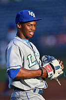 Outfielder Khalil Lee (9) of the Lexington Legends warms up prior to a game against the Greenville Drive on Wednesday, April 12, 2017, at Fluor Field at the West End in Greenville, South Carolina. Greenville won, 4-1. (Tom Priddy/Four Seam Images)