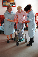 Elderly resident of a care home with her nurses. This image may only be used to portray the subject in a positive manner..©shoutpictures.com..john@shoutpictures.com