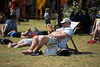 Hay on Wye. Sunday 05 June 2016<br />A man reads a book on the green at the Hay Festival, Hay on Wye, Wales, UK