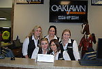 Oaklawn workers at the information desk before the running of the Southwest Stakes (Grade III) at Oaklawn Park in Hot Springs, Arkansas on February 17, 2014. (Credit Image: © Justin Manning/Eclipse/ZUMAPRESS.com)