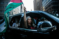 NEW YORK, NY - JUNE 15: A pro-Palestinian woman waves a flag inside a car during a large protest in New York on June 15, 2021. The solidarity action of hundreds of pro-Palestinians is a form of support against the attacks carried out by the Israeli government. At the same time, Palestinian Prime Minister Mohammad Shtayyeh says the new Israeli government is just as bad as the old one and condemns Naftali Bennett's announcements in support of Israeli settlements. That is why the demonstrations continue in different parts of the world. (Photo by Pablo Monsalve / VIEWpress via Getty Images