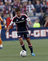 New England Revolution midfielder Ryan Guy (13) at midfield. In a Major League Soccer (MLS) match, the New England Revolution tied Houston Dynamo, 2-2, at Gillette Stadium on May 19, 2012.