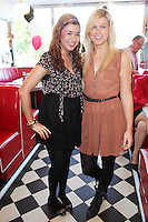 """NO REPRO FEE. 26/5/2011. NEW EDDIE ROCKET'S SHAKE SHOP. Julie Monaghan and Katie Byrne are pictured in the new Eddie Rocket's Shake Shop. The design seeks to recall the vintage milkshake bars from 1950's America and re-imagine them for the 21st century. The new look aims to appeal to both young and old with a quirky and bold colour scheme and a concept of make-your-own milkshakes, based on the tag line """"You make it...We shake it!"""". Eddie Rocket's City Diner in the Stillorgan Shopping Centre in south Dublin has re-opened after an exciting re-vamp and the addition of a Shake Shop. Ten new jobs have been created with the Diner's re-launch bringing the total working in Eddie Rocket's Stillorgan to 30. Picture James Horan/Collins Photos"""