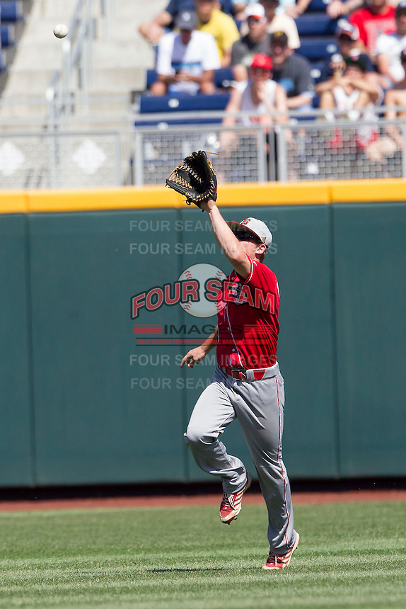 North Carolina State outfielder Brett Williams (3) makes a running catch during Game 3 of the 2013 Men's College World Series between the North Carolina State Wolfpack and North Carolina Tar Heels at TD Ameritrade Park on June 16, 2013 in Omaha, Nebraska. The Wolfpack defeated the Tar Heels 8-1. (Andrew Woolley/Four Seam Images)