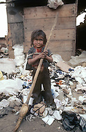 Children working in garbage dump. Bogota, Colombia - Child labor as seen around the world between 1979 and 1980 - Photographer Jean Pierre Laffont, touched by the suffering of child workers, chronicled their plight in 12 countries over the course of one year.  Laffont was awarded The World Press Award and Madeline Ross Award among many others for his work.