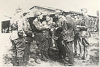 BNPS.co.uk (01202) 558833<br /> Pic: Spink&Son/BNPS<br /> <br /> Pictured: Captain William Algie (third left)<br /> <br /> The heroics of an all-action British officer during a daring trench raid can be revealed after his gallantry medals emerged for sale.<br /> <br /> Captain William Algie led from the front killing eight of the enemy with his revolver, then hurled bombs to keep their reinforcements at bay.<br /> <br /> He subsequently blew up a German ammunition dump, took prisoners, tended to wounded soldiers and withdrew his men under heavy fire.<br /> <br /> A few months later, Capt Algie converted to the Royal Flying Corps and became part of an acclaimed duo who took part in bombing, special operations and photo reconnaissance raids over France.<br /> <br /> After completing his pilot training, he was posted to the 'home defence' force, flying Sopwiths in pursuit of Gotha Bombers who launched raids on London and south east England. His medal group, including a Distinguished Service Order, is tipped to fetch £3,500 with auctioneers Spink & Son.