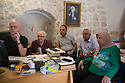Jerusalem - Father Stewart Columba showing to the Khalidys the online platform where the digital copies of the family's manuscript collection will be accessible. Originally opened in 1900, the Khalidy Library is the largest Palestinian library, hosting one of the best private collections of  manuscripts in the Arab world on subjects such as religion, science, phylosophy, poetry and history. The Library hosts 1,200 manuscripts, which are currently being digitized by local teams in collaboration with Father Stewart Columba and the HMML.