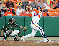 First baseman Jon McGibbon (12) of the Clemson Tigers in a game against the William & Mary Tribe on Opening Day, Friday, February 15, 2013, at Doug Kingsmore Stadium in Clemson, South Carolina. Clemson won, 2-0. (Tom Priddy/Four Seam Images)