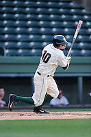 Shortstop Ryan Richardson (10) of the Michigan State Spartans bats in a game against the Harvard Crimson on Saturday, March 15, 2014, at Fluor Field at the West End in Greenville, South Carolina. Michigan State won, 4-0. (Tom Priddy/Four Seam Images)
