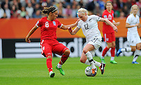 Betsy Hassett (r) of team New Zealand and Fara Williams of team England during the FIFA Women's World Cup at the FIFA Stadium in Dresden, Germany on July 1st, 2011.