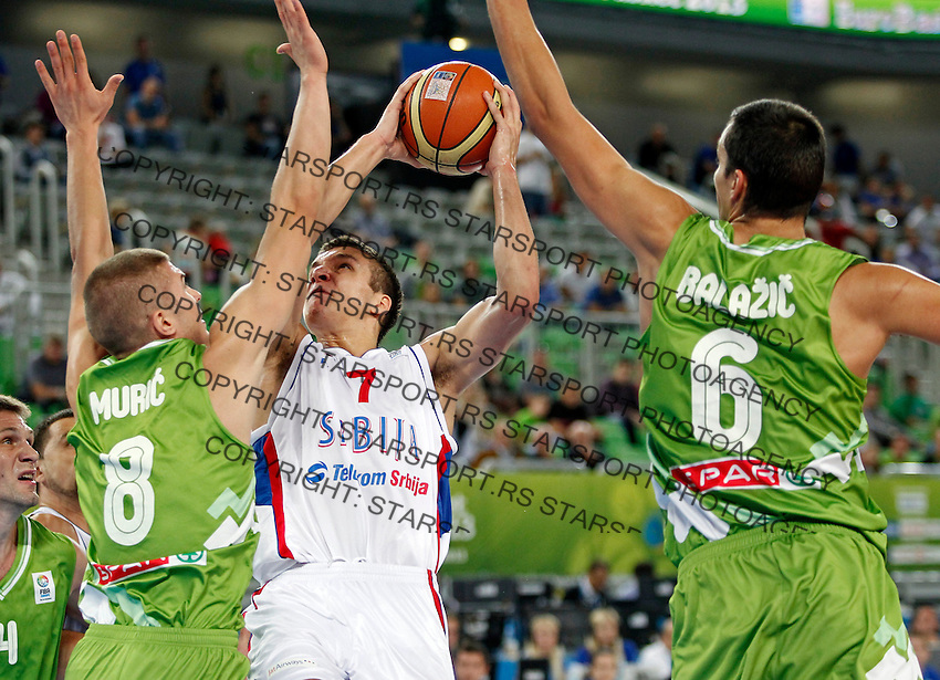 """Bogdan Bogdanovic of Serbia (C) in action during European basketball championship """"Eurobasket 2013"""" classification basketball game from 5th to 8th place between Serbia and Slovenia in Stozice Arena in Ljubljana, Slovenia, on September 19. 2013. (credit: Pedja Milosavljevic  / thepedja@gmail.com / +381641260959)"""