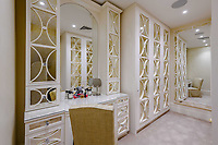 BNPS.co.uk (01202) 558833. <br /> Pic: TailorMade/BNPS<br /> <br /> Pictured: 'Her' dressing room. <br /> <br /> A multi-millionaire is hoping to have a shot at selling his luxury mansion - by throwing a hi-tech golf simulator into the deal.<br />  <br /> Golf-loving Barry Bester put the waterfront property on Sandbanks, Dorset, on the market for £11m last year.<br />  <br /> He is now offering his £40,000 state-of-the-art simulator he has had built on the grounds with the sale.
