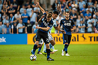 Kansas City, KS - Wednesday August 9, 2017: Tommy Thompson, Roger Espinoza during a Lamar Hunt U.S. Open Cup Semifinal match between Sporting Kansas City and the San Jose Earthquakes at Children's Mercy Park.