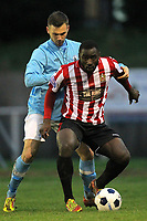 Tambeson Eyong of Hornchurch shields the ball from Joe Anderson of Billericay - AFC Hornchurch vs Billericay Town - Blue Square Conference South Football at The Stadium, Upminster Bridge, Essex - 29/12/12 - MANDATORY CREDIT: Gavin Ellis/TGSPHOTO - Self billing applies where appropriate - 0845 094 6026 - contact@tgsphoto.co.uk - NO UNPAID USE