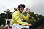 September 05, 2009: Jockey Mick Kinane makes the 5 sign after his mount Sea The Stars won his fifth Group One race. The Tattersalls Millions Irish Champion Stakes. Leopardstown Racecourse, Dublin, Ireland.