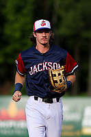 Jackson Generals outfielder Ryan Grotjohn (8) jogs into the dugout between innings of a Southern League game against the Biloxi Shuckers on June 14, 2019 at The Ballpark at Jackson in Jackson, Tennessee. Jackson defeated Biloxi 4-3. (Brad Krause/Four Seam Images)