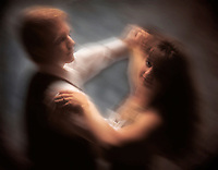 a couple ballroom dancing in soft focus. ballroom dancers, couples.