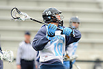 Baltimore- February 4: Greg Edmonds of Hopkins fires at the goal during the exhibition between Johns Hopkins and Penn State at Homewood Field on February 04, 2012 in Baltimore, MD.