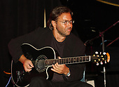 FORT LAUDERDALE FL - MAY 08: Al Di Meola performs during the Brazilian children's charity event held at the Fort Lauderdale Marriott on May 8, 2002 in Fort Lauderdale, Florida. : Credit Larry Marano © 2002
