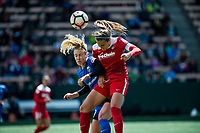 Seattle, WA - Saturday May 13, 2017: Shelina Zadorsky and Beverly Yanez during a regular season National Women's Soccer League (NWSL) match between the Seattle Reign FC and the Washington Spirit at Memorial Stadium.