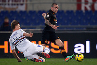 Calcio, ottavi di finale di Coppa Italia Tim: Roma vs Sampdoria. Roma, stadio Olimpico, 9 gennaio 2014.<br /> AS Roma midfielder Radja Nainggolan, of Belgium, is tackled by Sampdoria defender Bartosz Salamon of Poland, left, during the Italy Cup round of sixteen football match between AS Roma and Sampdoria at Rome's Olympic stadium, 9 January 2014.<br /> UPDATE IMAGES PRESS/Isabella Bonotto
