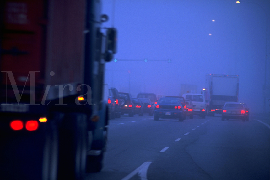 Canadian rush hour traffic on a misty, early morning roadway leading to Vancouver. Canada.