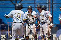 GCL Pirates right fielder Jeremias Portorreal (16) is congratulated by Mason Martin (22), Manny Bejerano (58) after hitting a grand slam home run in the top of the eleventh inning during a game against the GCL Blue Jays on July 20, 2017 at Bobby Mattick Training Center at Englebert Complex in Dunedin, Florida.  GCL Pirates defeated the GCL Blue Jays 11-6 in eleven innings.  (Mike Janes/Four Seam Images)