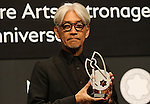 """December 21, 2016, Tokyo, Japan - Japanese composer Ryuichi Sakamoto, a member of the Yellow Magic Orchestra (YMO) displays a special fountain pen after he received Montblanc de la Culture Arts Patronage Award in Tokyo on Wednesday, December 21, 2016. Sakamoto played his screen music """"Merry Christmas Mr. Lawrence"""" with young musicians.  (Photo by Yoshio Tsunoda/AFLO) LWX -ytd-"""