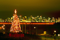 North Vancouver, BC, British Columbia, Canada - Christmas Tree Lights against Downtown Vancouver City Skyline