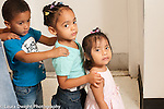 Education preschool first days of school 2-3 year olds Row of three children standing in line