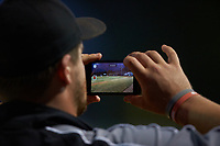 Mooresville Spinners coach Logan Welch uses his smart phone to record video during the game against the Dry Pond Blue Sox at Moor Park on July 2, 2020 in Mooresville, NC.  The Spinners defeated the Blue Sox 9-4. (Brian Westerholt/Four Seam Images)