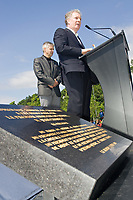 Quebec Premier Jean Charest speaks to the media as Daniel Gelinas, President and Director General of the Societe du 400e anniversaire de Quebec, looks on at the inauguration of the Promenade Samuel-de-Champlain Tuesday June 24, 2008 in Quebec City. The Promenade, a 2.5km parkway along the St-Lawrence River, is the gift from the government of Quebec to Quebec city for her 400th's birthday<br /> <br /> PHOTO :  Francis Vachon - Agence Quebec Presse